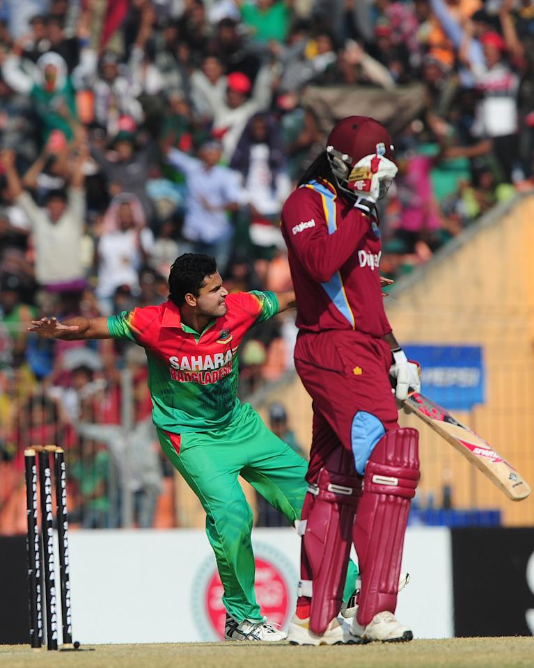 Bangladesh cricketer Mashrafe Bin Murtaza (L) reacts after the dismissal of the West Indies cricketer Chris Gayle during the second one day international cricket match between Bangladesh and the West Indies at the Sheikh Abu Naser Stadium in Khulna on December 2, 2012. AFP PHOTO/ Munir uz ZAMAN