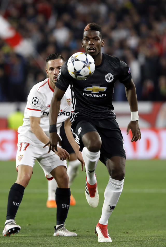 Manchester United's Paul Pogba controls the ball during the Champions League round of sixteen first leg soccer match between Sevilla FC and Manchester United at the Ramon Sanchez Pizjuan stadium in Seville, Spain, Wednesday, Feb. 21, 2018. (AP Photo/Miguel Morenatti)