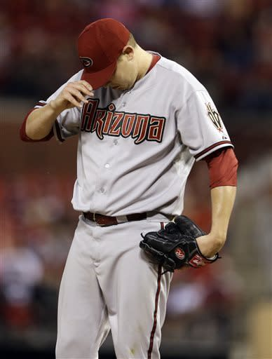 Arizona Diamondbacks starting pitcher Trevor Cahill pauses on the mound during the fourth inning of a baseball game against the St. Louis Cardinals Monday, June 3, 2013, in St. Louis. (AP Photo/Jeff Roberson)