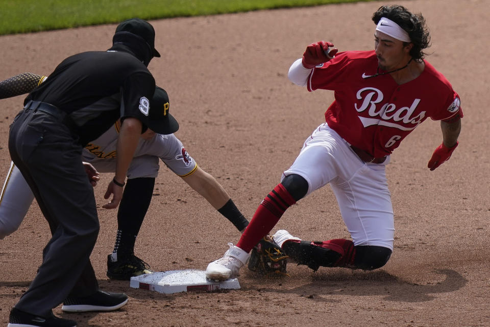 Cincinnati Reds' Jonathan India (6) is tagged out at second base during the seventh inning of a baseball game against the Pittsburgh Pirates at Great American Ball Park in Cincinnati, Wednesday, April 7, 2021. (AP Photo/Bryan Woolston)