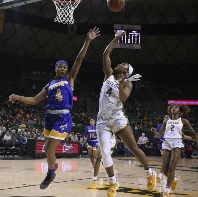 Baylor guard Te'a Cooper, front right, scores over Morehead State guard Tomiyah Alford, left, in the first half of an NCAA college basketball game, Monday, Dec. 30, 2019, in Waco, Texas. (Rod Aydelotte/Waco Tribune Herald, via AP)