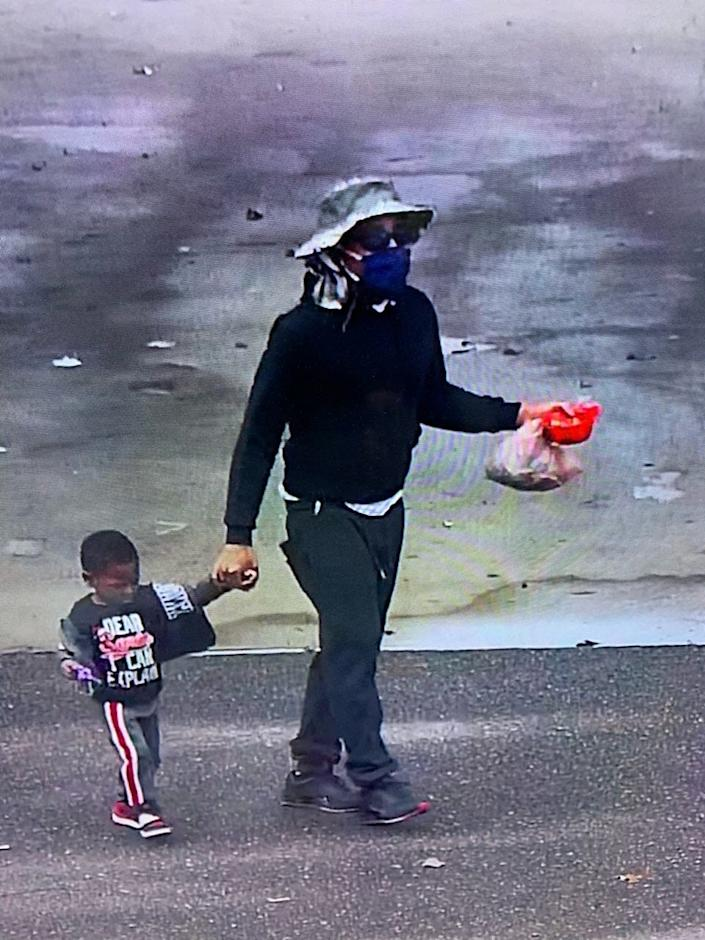 Security camera footage of a man abandoning an unnamed toddler at the Southaven Goodwill