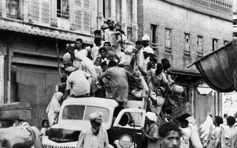 "70 years ago, Partition came into effect, dividing British India into two new, independent countries: India and Pakistan. At midnight on August 14 1947, Jawaharlal Nehru, the first prime minister of independent India, gave a famous speech which hailed the country's decades-long, non-violent campaign against British rule: At the stroke of the midnight hour, when the world sleeps, India will awake to life and freedom. A moment comes, which comes but rarely in history, when we step out from the old to the new, when an age ends, and when the soul of a nation, long suppressed, finds utterance.  However, it soon dawned on the leaders of both countries that the hope and optimism of that night would quickly turn to the harsh realities of how to handle one of the largest mass migrations in modern history and the ensuing communal violence. As India and Pakistan celebrate 70 years of independence, we look back at how two nations were formed - and the years of bloodshed that followed. A 'Google Doodle' on August 15 to celebrate Indian independence How did Indian and Pakistani independence come about? The Indian independence movement began in 1857. The early proponents led militant uprisings against British rule, but the leaders of the Indian National Congress, which was founded in 1885, pushed for more rights for Indians in terms of the vast civil service and land ownership.  From the 1920s onwards, Mahatma Gandhi was established as the leader of the Indian independence movement. His belief in civil rights and non-violent struggle inspired a generation. Many inspirational activists came to the fore, such as B. R. Ambedkar, who championed greater rights for the lower castes, that had been treated despicably under British colonial rule. In 1942, Congress launched the ""Quit India"" movement. Britain, leading the fight against Nazism in the Second World War alongside 2.5 million Indian troops, promised to grant India independence after the war. Following the Battle of Britain, Gandhi said he would not push for India's self-rule out of the ashes of a destroyed Britain. Mahatma Gandhi in 1947 Credit: Royston Leonard / mediadrumworld However, by the end of the war and with its empire weakened, Britain was unable to resist the overwhelming demand for independence. Both Congress and the Muslim League, led by Muhammad Ali Jinnah, dominated elections. Further, Clement Attlee, by now Britain's prime minister, was a supporter of independence. In a climate of growing communal tensions and pressure from Jinnah, who argued that Muslims should have their own state, the Mountbatten Plan was hastily conceived. It divided British India along broad religious lines. The problem being that there were millions of Muslims living in what would become Hindu-majority India and huge numbers of Hindus and Sikhs living in what would be Muslim-majority Pakistan. Mountbatten and Jinnah Credit: Royston Leonard / mediadrumworld Sir Cyril Radcliffe, who led the Boundary Commission, proposed the Radcliffe Line, which was a ""notional division"" of the vast country based on simple district majorities. He submitted his plan for both the west and east borders on August 9 1947 - just five days before it came into force. The two countries celebrate on different days because Lord Mountbatten, the viceroy of British India, had to attend the Pakistan celebration on August 14th and then travel to Delhi for India's first independence day on August 15. King George VI remained the head of state of India until the enshrining of the country's constitution in 1950. Likewise, Pakistan remained a Dominion of the Crown until 1956, when its constitution came into force. Indian Independence 
