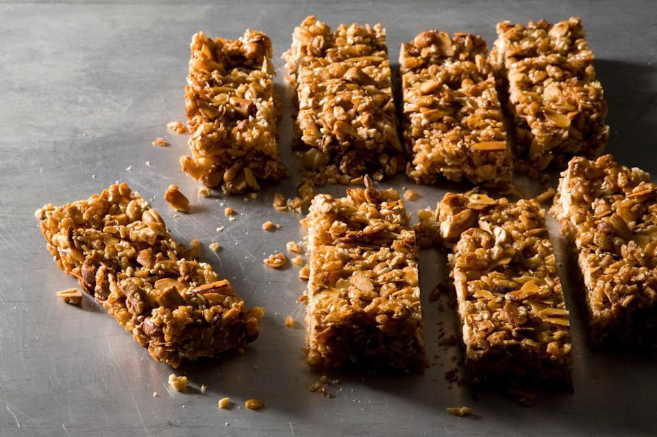 """Yup, you can make granola bars yourself—and you should, because they're so easy to make. Pack them up and bring them along for a mid-morning snack before getting out the rest of your picnic food. <a href=""""https://www.epicurious.com/recipes/food/views/chewy-nut-and-cereal-bars-358119?mbid=synd_yahoo_rss"""" rel=""""nofollow noopener"""" target=""""_blank"""" data-ylk=""""slk:See recipe."""" class=""""link rapid-noclick-resp"""">See recipe.</a>"""