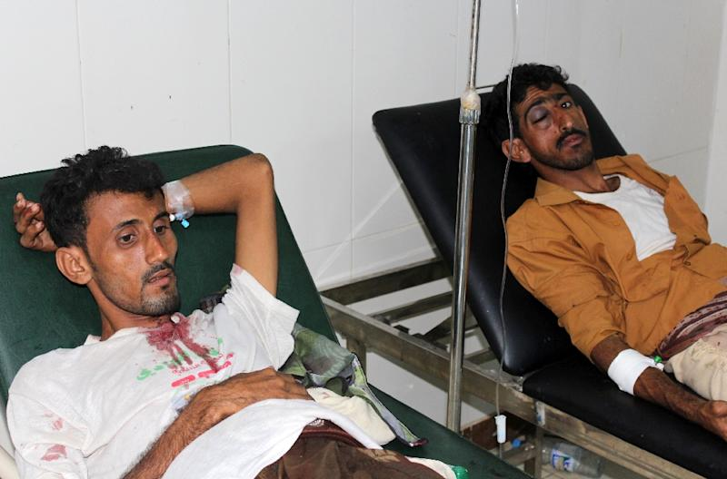 Yemeni men lie in hospital beds on January 17, 2016 in the southern city of Aden after they were injured in a suicide car bombing outside the residence of the police chief