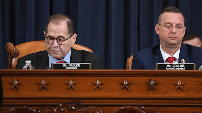 House Judiciary Committee Chairman Jerry Nadler and Rep. Doug Collins, the top Republican on the committee, prior to the vote on the articles of impeachment against President Trump on Friday. (Photo: Saul Loeb/AFP via Getty Images)
