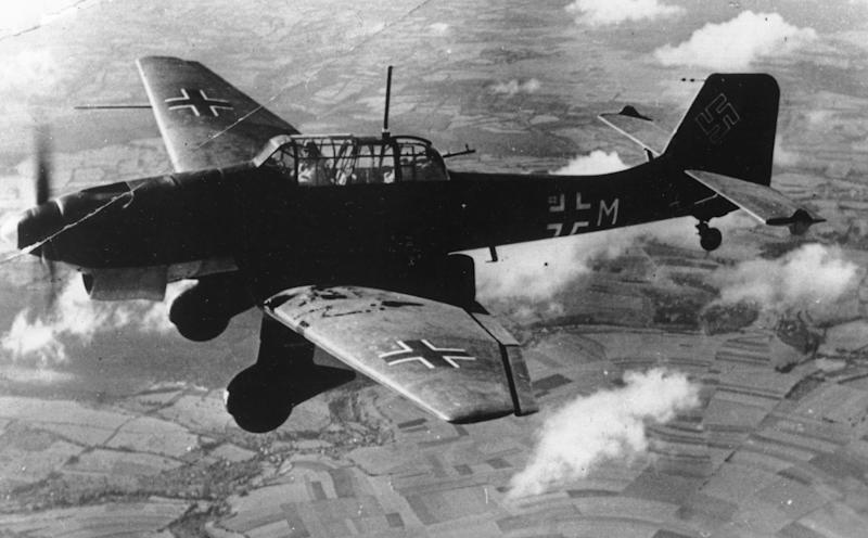 FILE - In this Nov. 1, 1940 b/w file picture a German dive bomber Ju 87 Stuka flies over an unknown location during World War II. German military museum is preparing to hoist the wreck of a Stuka dive bomber from the floor of the Baltic Sea, a rare remaining example of the plane that once wreaked havoc over Europe as part of the Nazis' war machine. The Stuka wreck, first discovered in the 90s when a fisherman's net snagged on it, lies about 10 kilometers off the coast of the Baltic island of Ruegen, in about 18 meters of water. German military divers have been working for a week to prepare the main body to be hoisted to the surface, and initial reports are that it is in good condition. The motor was brought up over the weekend. The German Military Historical Museum says it will be restored and put on display in Berlin. (AP Photo,File)