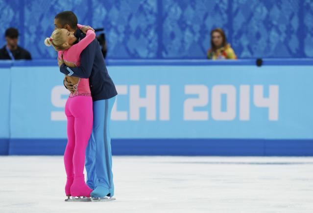 Germany's Aliona Savchenko and Robin Szolkowy celebrate during the Figure Skating Pairs Short Program at the Sochi 2014 Winter Olympics