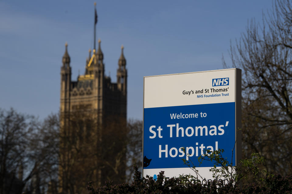 LONDON, ENGLAND - APRIL 07: A sign for St Thomas' Hospital is seen in front of the Houses of Parliament on April 07, 2020 in London, England. Prime Minister Boris Johnson was transferred to the intensive care unit at St Thomas' Hospital after his coronavirus symptoms worsened last night. (Photo by Justin Setterfield/Getty Images)