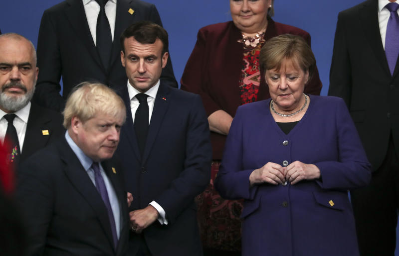 British Prime Minister Boris Johnson, President of France Emmanuel Macron and Chancellor of Germany Angela Merkel stand onstage during the annual NATO heads of government summit on December 4, 2019 in Watford, England. Photo: Steve Parsons-WPA Pool/Getty Images