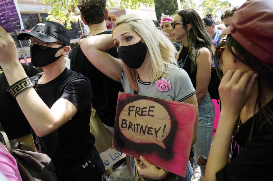 Britney Spears supporter Krista Robinson, of Los Angeles, waits to hear news outside a court hearing concerning the pop singer's conservatorship at the Stanley Mosk Courthouse, Wednesday, June 23, 2021, in Los Angeles. (AP Photo/Chris Pizzello)