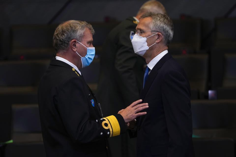 NATO Secretary General Jens Stoltenberg, right, talks to Chair of the NATO Military Committee Admiral Rob Bauer during a NATO Foreign Ministers video meeting following developments in Afghanistan at the NATO headquarters in Brussels, Friday, Aug. 20, 2021. (AP Photo/Francisco Seco, Pool)