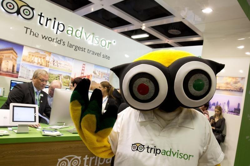 A mascot of tripadvisor is seen at its stand at the International Tourism Trade Fair (ITB) in Berlin