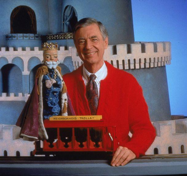 PHOTO: Fred Rogers smiles while posing with a toy trolley on the set of his television show 'Mister Rogers' Neighborhood.' (Getty Images)