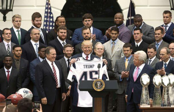 PHOTO: President Donald Trump, center, displays a jersey while standing with Bill Belichick, coach of the New England Patriots, left, and Robert Kraft, owner of the New England Patriots LP, right, at the White House in Washington, D.C., April 19, 2017. (Molly Riley/Pool via Bloomberg via Getty Images)