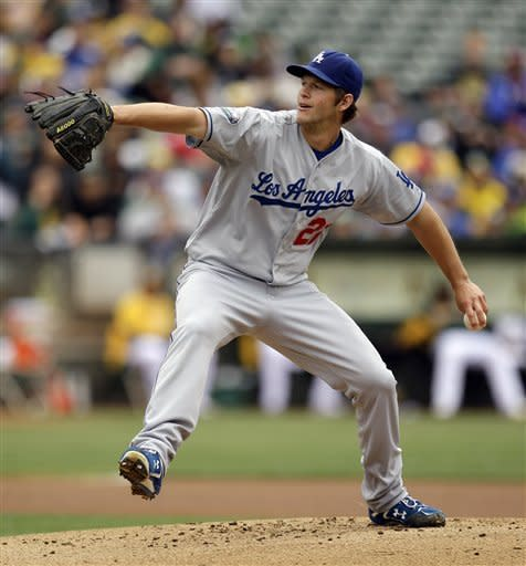 Los Angeles Dodgers' Clayton Kershaw works against the Oakland Athletics in the first inning of a baseball game, Thursday, June 21, 2012, in Oakland, Calif. (AP Photo/Ben Margot)