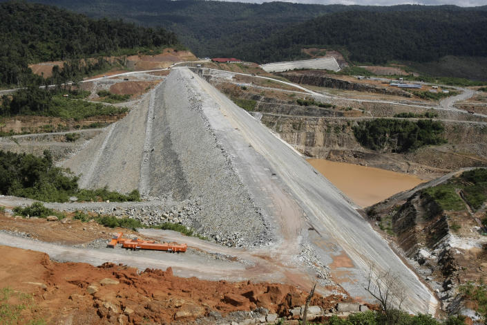 This Oct. 6, 2012 photo shows a construction site of a dam being built by China National Heavy Machinery Corporation on the Tatay River in Koh Kong province, some 210 kilometers (130 miles) west of Phnom Penh, Cambodia. Up a sweeping, jungle valley in a remote corner of Cambodia, Chinese engineers and workers are raising a 100-meter- (330-foot) high dam over the protests of villagers and activists. Only Chinese companies are willing to tame the Tatay and other rivers of Koh Kong province, one of Southeast Asia's last great wilderness areas. (AP Photo/Heng Sinith)
