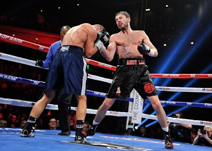 Andy Lee (R) throws a right at Matt Korobov during their fight. (Getty)