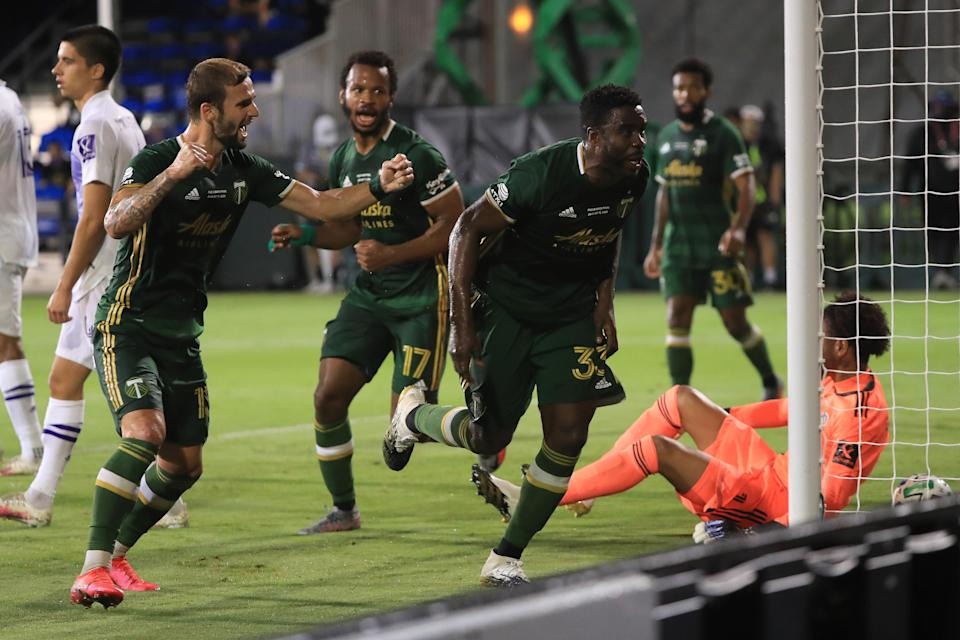 REUNION, FLORIDA - AUGUST 11: Larrys Mabiala #33 of Portland Timbers celebrates after scoring the opening goal of the final match of MLS Is Back Tournament between Portland Timbers and Orlando City at ESPN Wide World of Sports Complex on August 11, 2020 in Reunion, Florida. (Photo by Sam Greenwood/Getty Images)