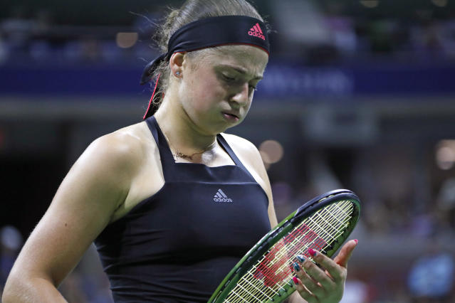 Jelena Ostapenko, of Latvia, reacts to losing a point to Maria Sharapova, of Russia, during the third round of the U.S. Open tennis tournament Saturday, Sept. 1, 2018, in New York. (AP Photo/Adam Hunger)