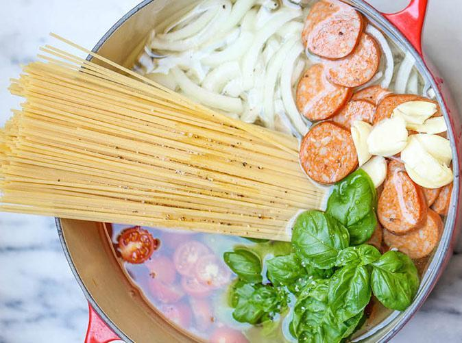 """<h2>11. Spaghetti with Parmesan and Andouille Sausage</h2> <p>It takes just five minutes to prep.</p> <p><a class=""""link rapid-noclick-resp"""" href=""""http://damndelicious.net/2014/05/16/one-pot-pasta/"""" rel=""""nofollow noopener"""" target=""""_blank"""" data-ylk=""""slk:Get the recipe"""">Get the recipe</a></p>"""