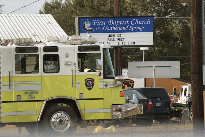 An emergency vehicle is parked outside the First Baptist Church of Sutherland Springs. (Photo: Scott Olson/Getty Images)