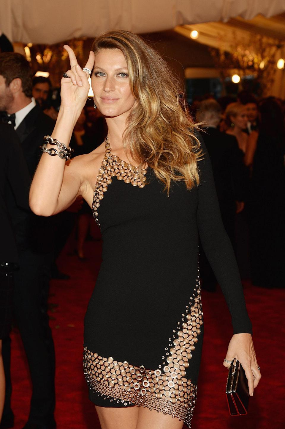 """<p>Gisele got into the """"punk"""" theme of the 2013 Met Gala with her pose that year. (Photo: Getty Images) </p>"""