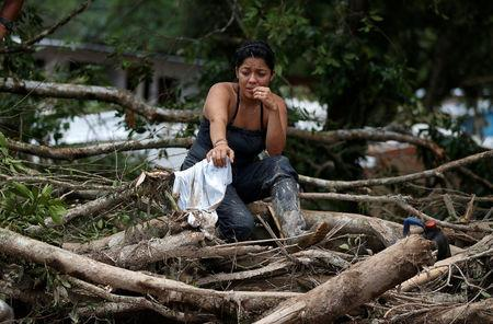 A woman is seen on a destroyed street after flooding and mudslides caused by heavy rains in Mocoa