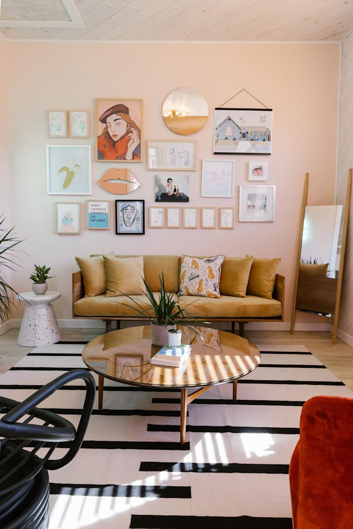 """<div class=""""caption""""> The Gallery feels like a space we'd want to spend a lot of time hanging out. Some favorite pieces: <a href=""""https://modshop1.com/collections/digitally-printed-pillows/products/le-leopard"""" rel=""""nofollow noopener"""" target=""""_blank"""" data-ylk=""""slk:Le Léopard pillow"""" class=""""link rapid-noclick-resp"""">Le Léopard pillow</a>, <a href=""""https://nordicknots.com/us/product/tiger-cream-black/"""" rel=""""nofollow noopener"""" target=""""_blank"""" data-ylk=""""slk:Tiger rug"""" class=""""link rapid-noclick-resp"""">Tiger rug</a>, and <a href=""""https://fave.co/3dgLcHi"""" rel=""""nofollow noopener"""" target=""""_blank"""" data-ylk=""""slk:Horizon mirror"""" class=""""link rapid-noclick-resp"""">Horizon mirror</a>. </div>"""