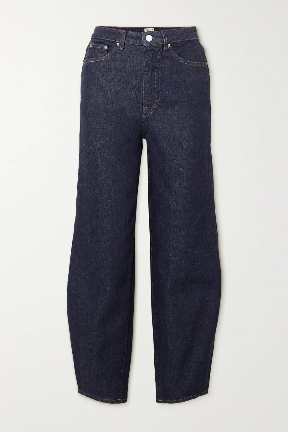 <p><span>Totême's High-Rise Tapered Jeans </span> ($320) make for an exaggerated look.</p>