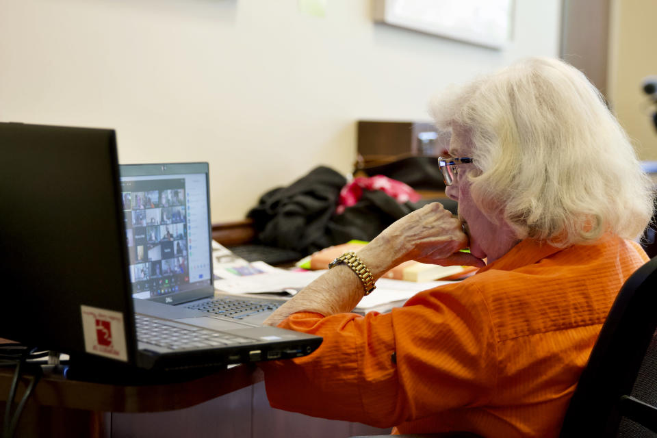 """Trudy Berlin hosts her weekly Zoom session at the Levis Jewish Community Center in Boca Raton, Fla., Tuesday, March 16, 2021. During the coronavirus pandemic, Berlin moved her in-person classes to Zoom. She's grown a steady audience of about 50 women from the U.S. and Canada who have come to view the class as a support group. Berlin says it's """"a whole new world out there"""" and she's having fun. (AP Photo/Cody Jackson)"""