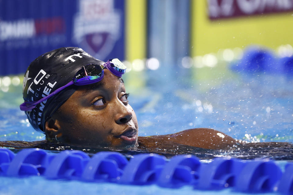 OMAHA, NEBRASKA - JUNE 17: Simone Manuel of the United States reacts after competing in a preliminary heat for the Women's 100m freestyle during Day Five of the 2021 U.S. Olympic Team Swimming Trials at CHI Health Center on June 17, 2021 in Omaha, Nebraska. (Photo by Tom Pennington/Getty Images)