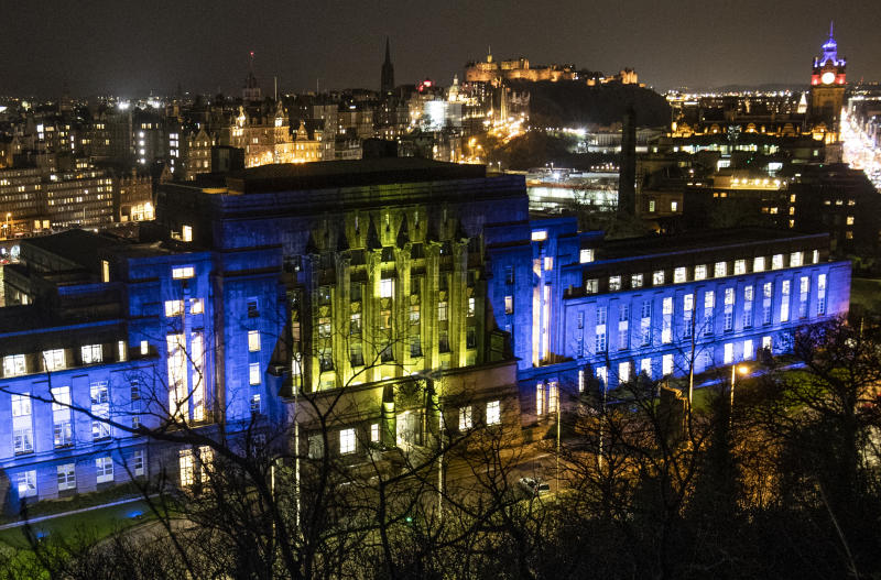 St Andrew's House, a Scottish Government building in Edinburgh, is illuminated in blue and yellow, the colours of the European flag, ahead of the UK leaving the European Union at 11pm on Friday.