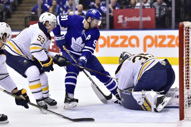 Buffalo Sabres goaltender Linus Ullmark (35) makes a save on Toronto Maple Leafs center John Tavares (91) as Sabres left wing Jeff Skinner (53) defends during the second period of an NHL hockey game, Monday, Feb. 25, 2019 in Toronto. (Frank Gunn/The Canadian Press via AP)