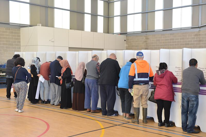 People arrive at a polling station to cast their votes during general elections to elect its parliament and prime minister in Melbourne, Australia on May 18, 2019. (Photo by Recep Sakar/Anadolu Agency/Getty Images)