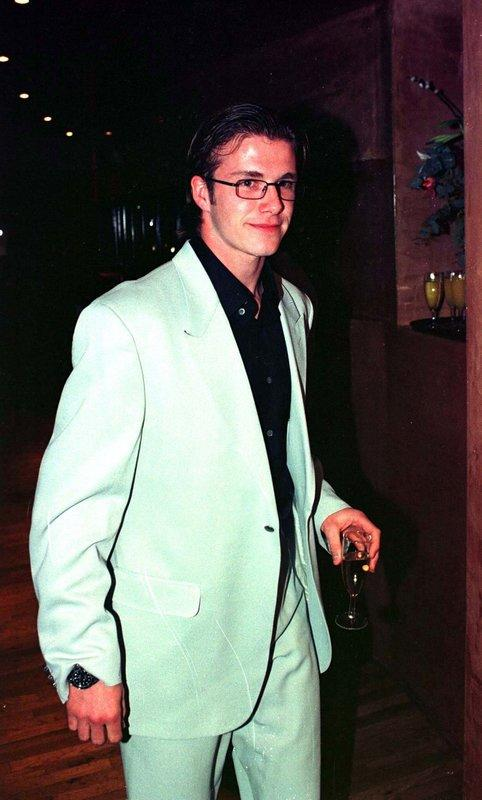 Donning a mint coloured suit in the 90s.