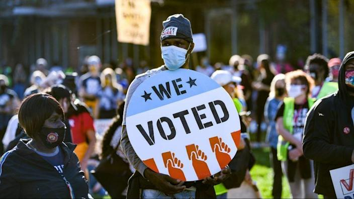 A view of voting rights signs as people gather during the Count Every Vote Rally In Philadelphia at Independence Hall on November 07, 2020 in Philadelphia, Pennsylvania. (Photo by Bryan Bedder/Getty Images for MoveOn)