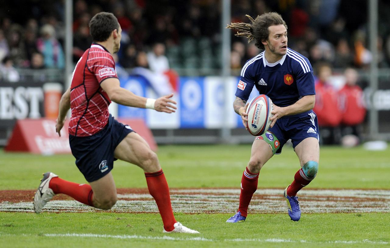 Terry Bouhraoua (R) of France in action against Russia during their Rugby Union Glasgow Sevens game at Scotstoun Stadium in Glasgow, Scotland, on May 4, 2013. France won the game 15-14. AFP PHOTO/ANDY BUCHANANAndy Buchanan/AFP/Getty Images