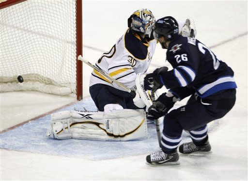 Winnipeg Jets' Blake Wheeler puts the puck past Buffalo Sabres goaltender Ryan Miller on a breakaway during the third period of an NHL hockey game in Winnipeg, Manitoba, Monday, March 5, 2012. (AP Photo/The Canadian Press, Trevor Hagan)