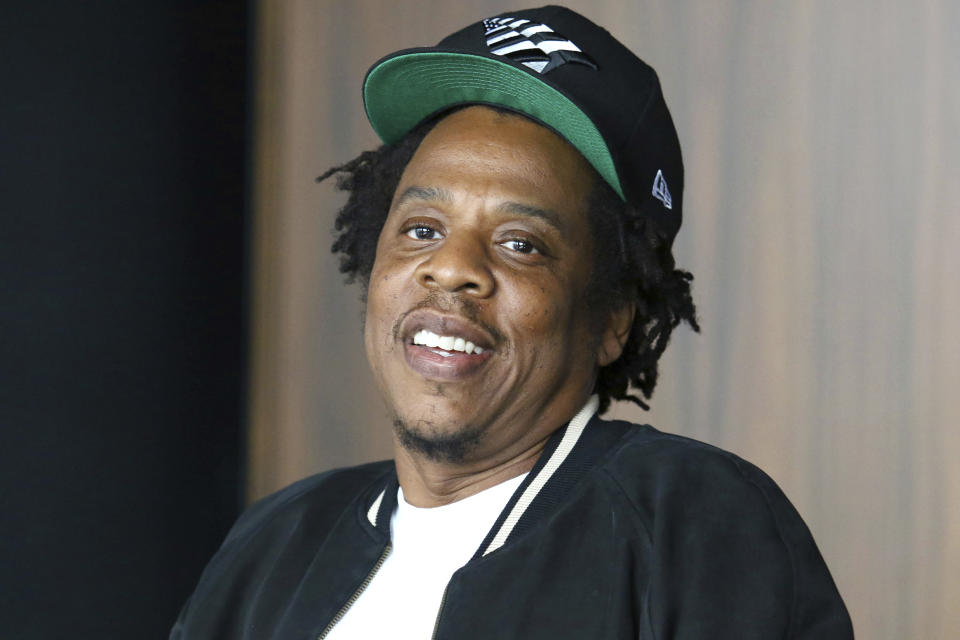 FILE - In this July 23, 2019, file photo, Jay-Z makes an announcement of the launch of Dream Chasers record label in joint venture with Roc Nation, at the Roc Nation headquarters in New York. Moet Hennessy is acquiring a 50% stake in the rapper and entrepreneur's Champagne brand, Armand de Brignac, in an effort to up its cool factor and expand sales. Jay-Z, whose real name is Shawn Carter, said the partnership will help Armand de Brignac grow and flourish. (Photo by Greg Allen/Invision/AP, File)