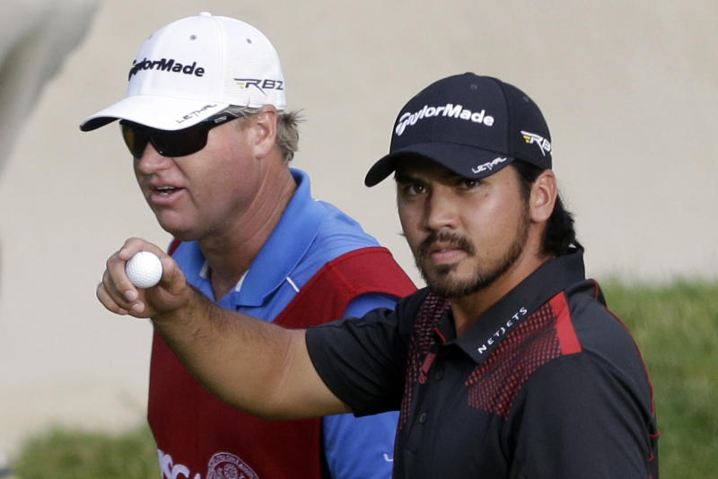 Jason Day, of Australia, acknowledges the gallery after putting on the 17th hole during the fourth round of the U.S. Open golf tournament at Merion Golf Club, Sunday, June 16, 2013, in Ardmore, Pa. (AP Photo/Gene J. Puskar)