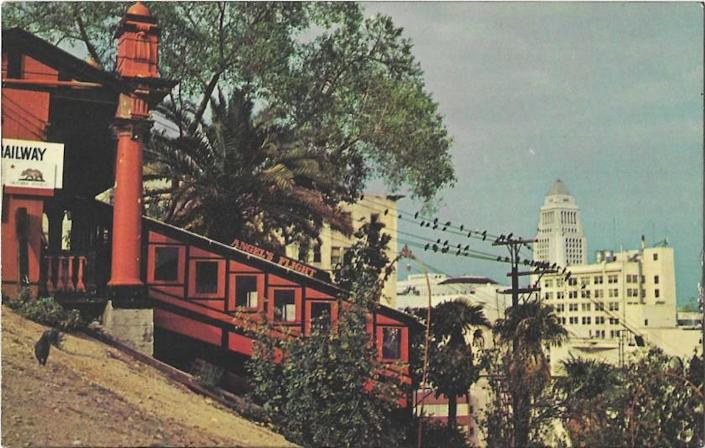 A postcard from the 1960s shows Angels Flight in operation with City Hall in the background.
