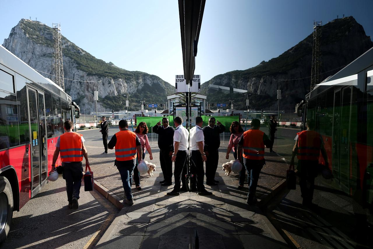 People walk at a bus stop in front of the Rock in the British overseas territory of Gibraltar, historically claimed by Spain, November 15, 2018. REUTERS/Jon Nazca     TPX IMAGES OF THE DAY