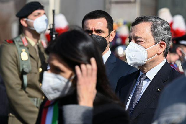 This photo taken on February 25, 2021 shows Italy's Prime Minister, Mario Draghi (R) and Rome mayor Virginia Raggi (Front L) leave after attending the state funerals of slain Italian Ambassador Luca Attanasio and Italian Carabinieri police officer, Vittorio Iacovacci, at the Basilica of St. Mary of the Angels and the Martyrs in Rome. - Italy's ambassador to the DRC and his bodyguard, Italian Carabinieri police officer Vittorio Iacovacci were killed on February 22, 2021 after armed assailants in the eastern DRC ambushed a convoy that was travelling to a World Food Programme (WFP) school feeding programme. (Photo by Vincenzo PINTO / AFP) (Photo by VINCENZO PINTO/AFP via Getty Images) (Photo: VINCENZO PINTO via Getty Images)