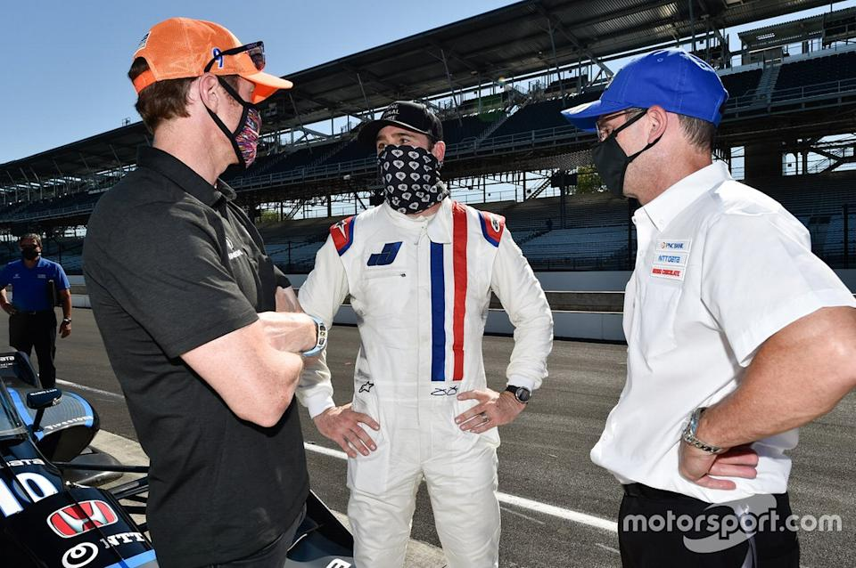 """Jimmie Johnson with Scott Dixon and Chip Ganassi Racing team manager Barry Wanser. <span class=""""copyright"""">Chris Owens</span>"""