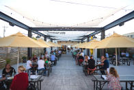 This photo provided by Adam M. Rammel shows the beer garden at The Syndicate on Aug. 20, 2020 in Bellefontaine, Ohio. Many restaurants, event planners and even companies like distillers and corporate gift manufacturers face weaker revenues although the holiday season is approaching. Owners contending with government restrictions or crumbling demand are trying to hold on _ some are creating new products and services or desperately searching for new customers. (Susie Jarvis/Adam M. Rammel via AP)