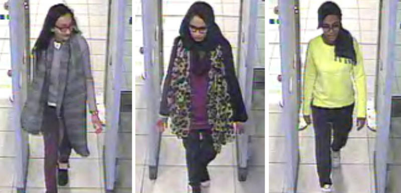 FILE - This Monday Feb. 23, 2015 file handout image of a three image combo of stills taken from CCTV issued by the Metropolitan Police shows Kadiza Sultana, left, Shamima Begum, center, and Amira Abase going through security at Gatwick airport, south England, before catching their flight to Turkey. Shamima Begum told The Times newspaper in a story published Thursday Feb. 14, 2019, that she wants to come back to London. (Metropolitan Police via AP)