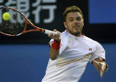 Stanislas Wawrinka of Switzerland hits a return to Rafael Nadal of Spain during their men's singles final match at the Australian Open 2014 tennis tournament in Melbourne January 26, 2014. REUTERS/Jason Reed