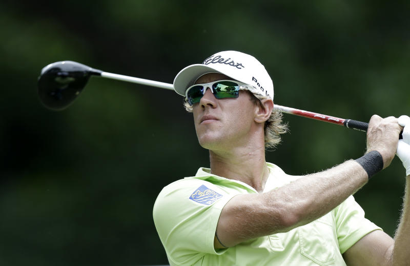 Graham DeLaet watches his tee shot on the second hole during the third round of the Colonial golf tournament Saturday, May 25, 2013, in Fort Worth, Texas. (AP Photo/LM Otero)