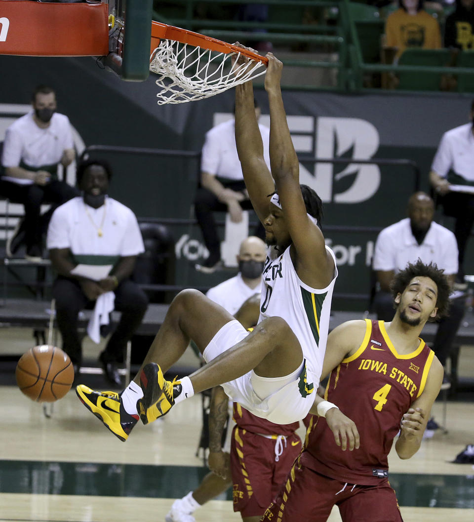 Baylor forward Flo Thamba (0) against Iowa State forward George Conditt IV (4) looks on in the second half of an NCAA college basketball game, Tuesday, Feb. 23, 2021, in Waco, Texas. (AP Photo/Jerry Larson)